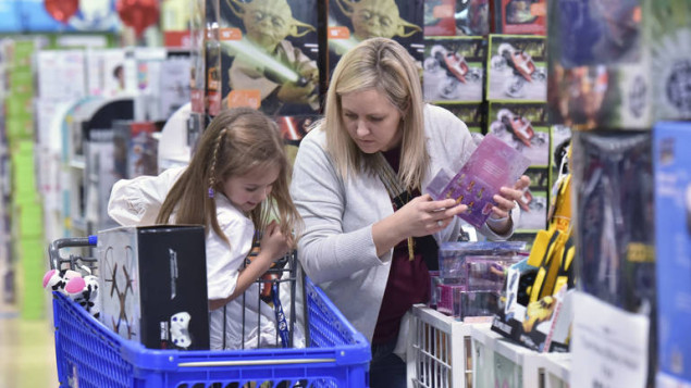 Stephanie Rowell and her daughter Sydney, 5, shop at Toys R Us - Town Center on Thanksgiving night Thursday, Nov. 24, 2016 in Kennesaw, Ga. (Hyosub Shin/Atlanta Journal-Constitution via AP)