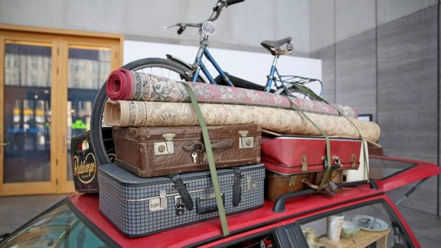 epa05276317 A picture made available 25 April 2016 shows a Volkswagen Polo loaded with suitcases, a bicylce and several rugs is parked in the Museum of Fine Arts in Leipzig, Germany, 22 April 2016. German-Syrian artist Manaf Halbouni is showcasing a conceptual art exhibition entitled 'Nowhere is home,' featuring two cars converted into living spaces, packed with personal items needed for day-to-day living, symbolizing the artist's inability to feel at home in Germany. Halbouni came up with the artistic adaptation of these cars as a reaction to the rallies of the anti-Islamic 'Patriotic Europeans Against the Islamisation of the West' (Pegida) movement in early 2015. The vehicles will be on display at the museum from 05 April to 26 June 2016.  EPA/JAN WOITAS