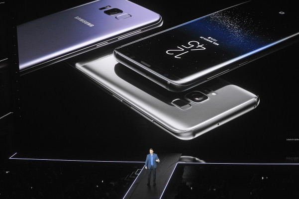 NEW YORK, NY - MARCH 29: Samsung Senior Vice President of Product Strategy Justin Denison unveils the Samsung Galaxy S8 and S8+ during Samsung Unpacked at David Geffen Hall on March 29, 2017 in New York City.   Brad Barket/Getty Images for Samsung/AFP