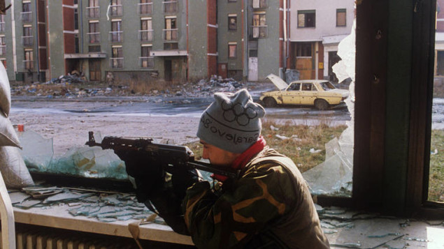 Bosnian soldier, wearing Olympic hat, takes position in the Olympic Village in the Suburbs of Sarajevo, Bosnia And Herzegovina, 11 February 1993. EPA/JANEK SKARZYNSKI