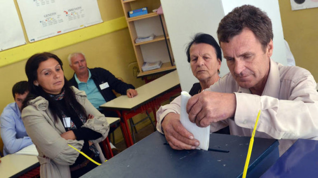 Bosnian voters cast their votes for local authorities, in the Eastern-Bosnian town of Srebrenica, on October 7, 2012. Srebrenica in a tense political stand-off faced local elections in Bosnia. National and political division between Bosnian Serbs and Muslims runs deep even 17 years after Bosnian Serbs stormed the town and surrounding villages by military force killing thousands of non-Serb population. AFP PHOTO ELVIS BARUKCIC        (Photo credit should read ELVIS BARUKCIC/AFP/GettyImages)