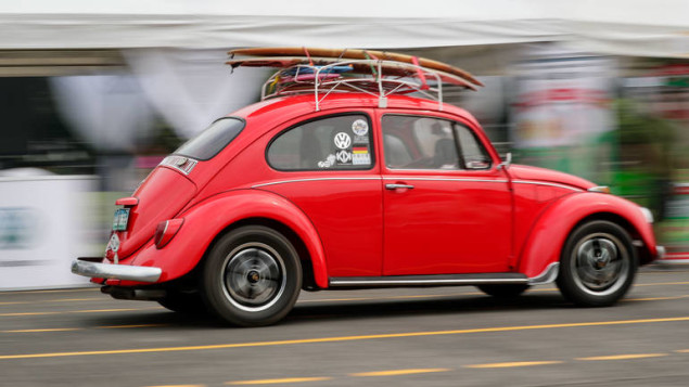 epa06380535 A red Volkswagen beetle at the 32nd Volkswagen Classic and Customs Car Show inside a military camp in Quezon City, north of Manila, Philippines, 10 December 2017.  EPA-EFE/MARK R. CRISTINO