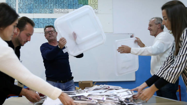 Election Commission officials count votes after presidential and parliamentary elections at a polling station in a school in Zenica, Bosnia and Herzegovina October 7, 2018. REUTERS/Dado Ruvic - RC1D6A27DC30