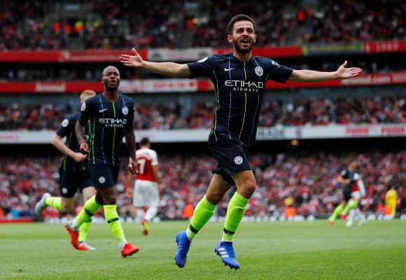 "Soccer Football - Premier League - Arsenal v Manchester City - Emirates Stadium, London, Britain - August 12, 2018   Manchester City's Bernardo Silva celebrates scoring their second goal   REUTERS/Eddie Keogh    EDITORIAL USE ONLY. No use with unauthorized audio, video, data, fixture lists, club/league logos or ""live"" services. Online in-match use limited to 75 images, no video emulation. No use in betting, games or single club/league/player publications.  Please contact your account representative for further details."